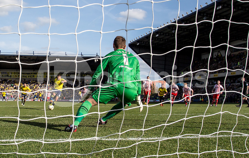 Liam Sercombe of Oxford United fires in his penalty but it is saved by Goalkeeper Jamie Jones of Stevenage during the Sky Bet League 2 match between Oxford United and Stevenage at the Kassam Stadium, Oxford, England on the 25th March 2016. Photo by Liam McAvoy.