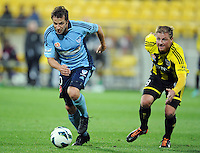 Sydney FC's Alessandro del Piero runs around the Phoenix's Ben Sigmund in the A-League foootball match at Westpac Stadium, Wellington, New Zealand, Saturday, October 06, 2012. Credit:SNPA / Ross Setford