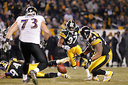 Anthony Madison (37) of the Pittsburgh Steelers eyes a fumble that was recovered by teammate LaMarr Woodley (56) against the Baltimore Ravens in the AFC Divisional Playoff game on Jan. 15, 2011 at Heinz Field in Pittsburgh, Pennsylvania. The Steelers won 31-24. (Photo by Joe Robbins)