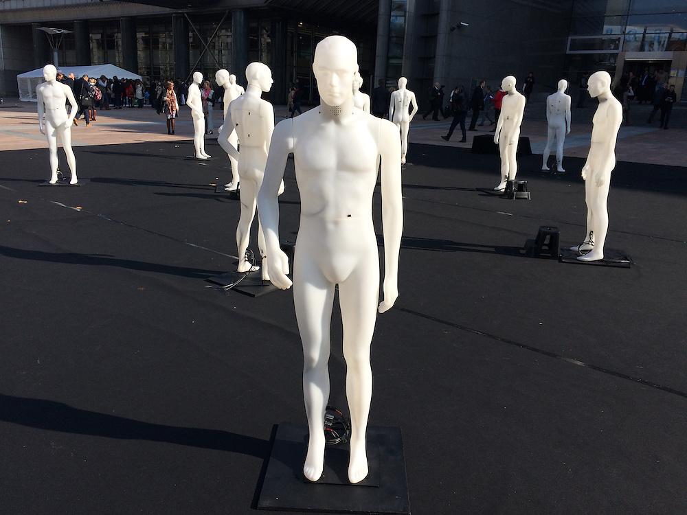 exhibition of standing men near EU parliament