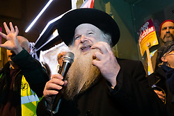 © Licensed to London News Pictures. 30/12/2019. London, UK. Rabbi Herschel Gluck speaking at a protest vigil against anti-semitic graffiti in Hampstead and Belsize Park, held in Rosslyn Hill in Hampstead. Yesterday, anti-semitic graffiti was daubed on a synagogue and several shops in north London during the Jewish festival of Hanukkah. Photo credit: Vickie Flores/LNP