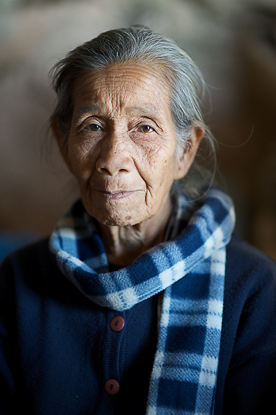 A Portrait of a elder Woman Portrait in a temple cave in Laos