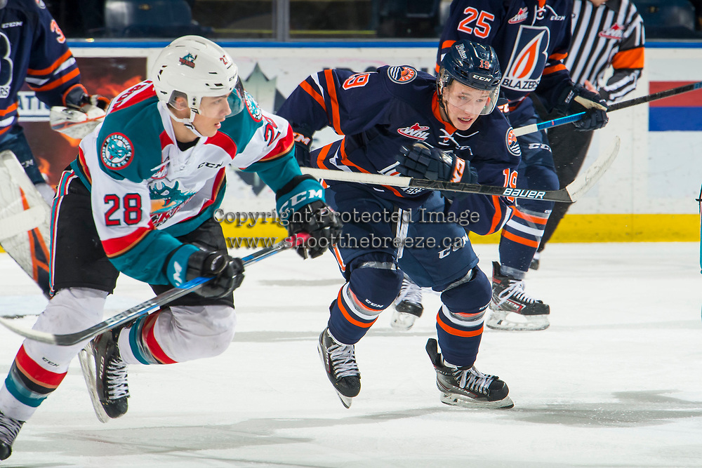 KELOWNA, BC - FEBRUARY 23: Orrin Centazzo #19 of the Kamloops Blazers and Leif Mattson #28 of the Kelowna Rockets skate up the ice at Prospera Place on February 23, 2019 in Kelowna, Canada. (Photo by Marissa Baecker/Getty Images)