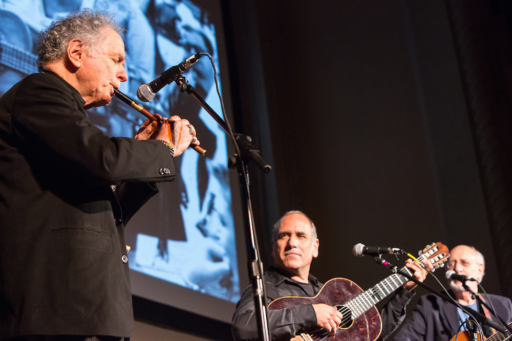 Composer and musician David Amram playing pennywhistle. To is right are Israeli singer-songwriter David Broza and Peter Yarrow.