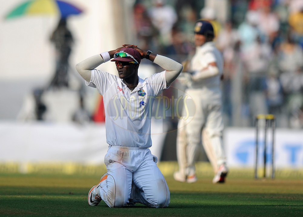 Darren Sammy captain of West Indies reacts after failing to catch a ball to get Sachin Tendulkar of India out during day one of the second Star Sports test match between India and The West Indies held at The Wankhede Stadium in Mumbai, India on the 14th November 2013<br /> <br /> This test match is the 200th test match for Sachin Tendulkar and his last for India.  After a career spanning more than 24yrs Sachin is retiring from cricket and this test match is his last appearance on the field of play.<br /> <br /> Photo by: Pal PIllai - BCCI - SPORTZPICS<br /> <br /> Use of this image is subject to the terms and conditions as outlined by the BCCI. These terms can be found by following this link:<br /> <br /> http://sportzpics.photoshelter.com/gallery/BCCI-Image-Terms/G0000ahUVIIEBQ84/C0000whs75.ajndY