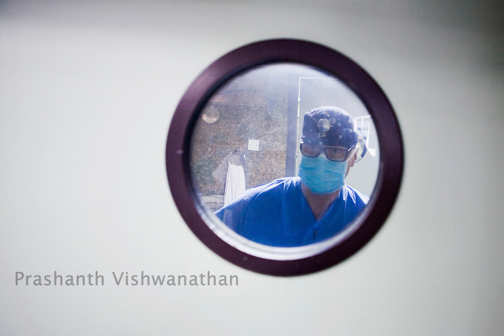 Professor, Juha Hernesniemi , enters the operation theatre before he performs a neurosurgery in front of 170 Indian neurosurgeons at Bombay Hospital in Mumbai, India, on Sunday, April 17, 2011. Photographer: Prashanth Vishwanathan/HELSINGIN SANOMAT