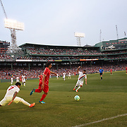 José Enrique, Liverpool, is challenged by Juan Manuel Iturbe, (left) and Michele Somma, AS Roma, in action during the Liverpool Vs AS Roma friendly pre season football match at Fenway Park, Boston. USA. 23rd July 2014. Photo Tim Clayton