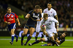 England replacement (#23) David Strettle (Saracens) is tackled by Scotland Number 8 (#8) Johnnie Beattie (Montpellier) during the second half of the match - Photo mandatory by-line: Rogan Thomson/JMP - Tel: Mobile: 07966 386802 02/02/2013 - SPORT - RUGBY UNION - Twickenham Stadium - London. England v Scotland - 2013 RBS Six Nations Championship. The winner of this fixture is awarded the Calcutta Cup.