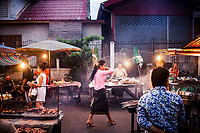Street vendors set up their table at the Ban Anou night market in Vientiane, Laos.