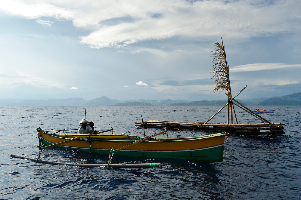 Fisherman at a 'Rumpon' FAD, nr Bangga, Gorontalo, Sulawesi, Indonesia.