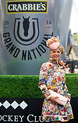 LIVERPOOL, ENGLAND - Friday, April 4, 2014: Catherine Lundon from Ireland wearing Fiona Mangan hat and outfit from Ted Baker during Ladies' Day on Day Two of the Aintree Grand National Festival at Aintree Racecourse. (Pic by David Rawcliffe/Propaganda)