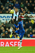 Jamaal Lascelles (#6) of Newcastle United leaps to clear the ball ahead of Ngolo Kante (#7) of Chelsea during the Premier League match between Newcastle United and Chelsea at St. James's Park, Newcastle, England on 18 January 2020.
