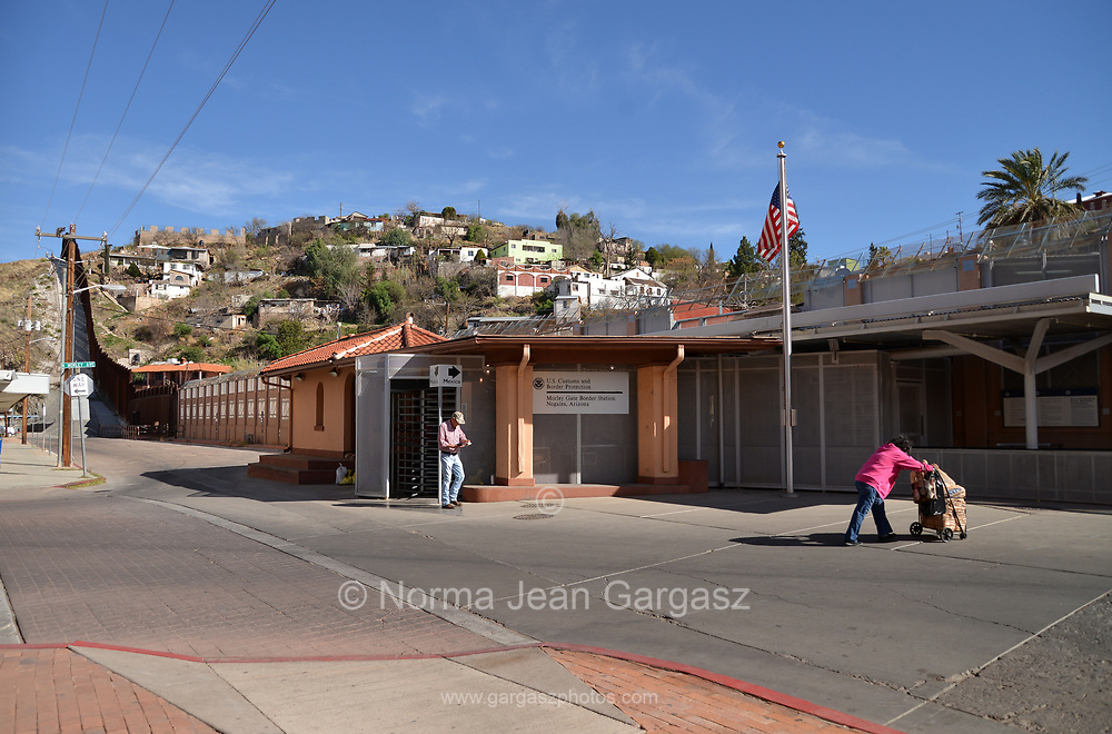Pedestrians cross between Arizona and Sonora, Mexico, at the U.S. Customs and Border Protection, Morley Gate Border Station, Nogales, Arizona, USA.