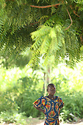 A Chadian refugee girl stands under a tree in the Langui refugee camp outside the town of Garoua, Cameroon on Thursday September 17, 2009.