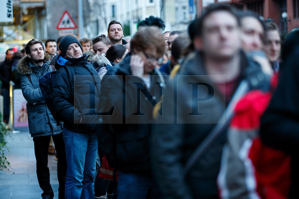 © Licensed to London News Pictures. 16/01/2015. LONDON, UK. People queuing outside 'La Page' book shop in London to buy a copy of Charlie Hebdo's survival edition on Friday, 16 January 2015. Photo credit : Tolga Akmen/LNP