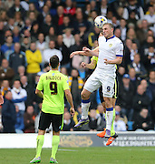Leeds United striker Chris Wood (9) wins a header during the Sky Bet Championship match between Leeds United and Brighton and Hove Albion at Elland Road, Leeds, England on 17 October 2015.