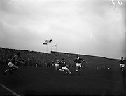 28/09/1960<br /> 09/28/1960<br /> 28 September 1960<br /> Soccer International: Ireland v Wales at Dalymount Park, Dublin. Wales won the game 3-2. Charlie Hurley the Irish centre back tackles Welsh centre-forward Graham Moore, during an attack on the Irish goal.