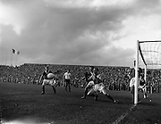 14/09/1960<br /> 09/14/1960<br /> 14 September 1960<br /> Soccer: League of Ireland v English Football League at Dalymount Park Dublin. Irish keeper Darcy covered by McCarthy right and Nolan (captn) defend the Irish goal. Greanmes (Football League) is centre..