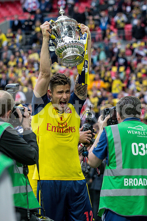 Oliver Giroud of Arsenal lifts the cup after the The FA Cup Final match between Arsenal and Aston Villa at Wembley Stadium, London, England on 30 May 2015. Photo by Liam McAvoy.