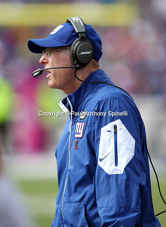New York Giants head coach Tom Coughlin calls out from the sideline during the 2015 NFL week 4 regular season football game against the Buffalo Bills on Sunday, Oct. 4, 2015 in Orchard Park, N.Y. The Giants won the game 24-10. (©Paul Anthony Spinelli)