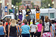 Middletown, New York - People listen to instructors from Studio Ayo during Zumba in the Street at the Run 4 Downtown road race on Aug. 18, 2012.