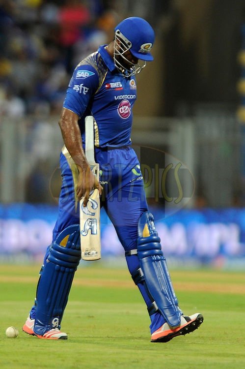 Kieron Pollard of Mumbai Indians walks back after getting out during match 46 of the Pepsi IPL 2015 (Indian Premier League) between The Mumbai Indians and The Royal Challengers Bangalore held at the Wankhede Stadium in Mumbai, India on the 10th May 2015.<br /> <br /> Photo by:  Pal Pillai / SPORTZPICS / IPL