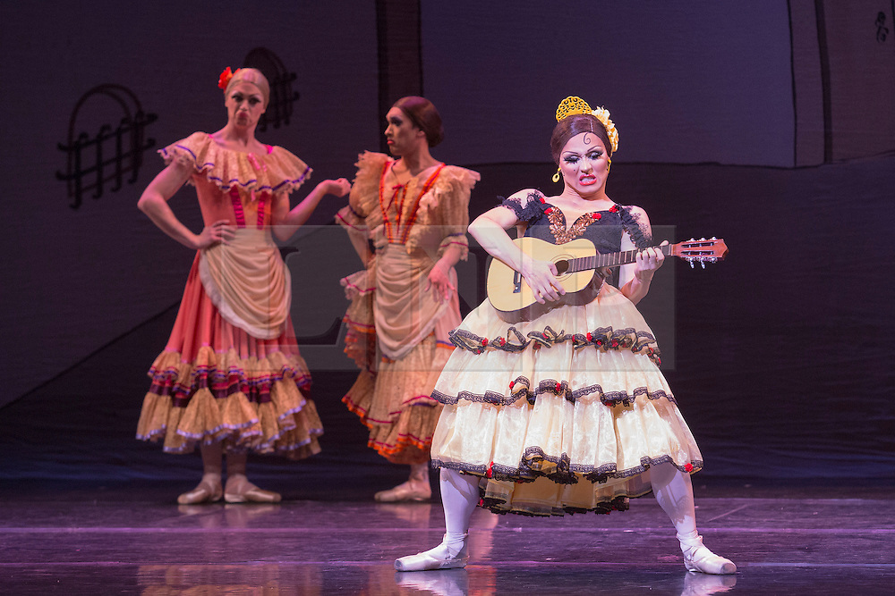 © Licensed to London News Pictures. 18/09/2015. London, UK. Yakaterina Verbosovich (Chase Johnsey) as Kitri. Les Ballets Trockadero de Monte Carlo (The Trocks) perform the UK premiere of Don Quixote during a photocall at the Peacock Theatre. With Yakaterina Verbosovich (Chase Johnsey) as Kitri, Vyacheslav Legupski (Paolo Cervellera) as Basil, Olga Supphozova (Robert Carter) as Amour, Lariska Dumbcheno (Raffaele Morra) as Mother, Boris Nowitsky (Carlos Renedo) as Count and Varvara Bractchikova (Giovanni Goffredo) and Eugenia Repelskii (Joshua Thake) as Gypsies. Photo credit: Bettina Strenske/LNP