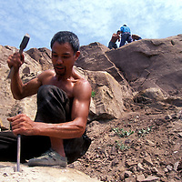 China, Hubei Province, Villagers work in stone quarry used to build new Yao Ping above Three Gorges Dam new water level