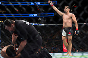 Vincente Luque celebrates after defeating Belal Muhammad during UFC 205 at Madison Square Garden in New York, New York on November 12, 2016.  (Cooper Neill for The Players Tribune)