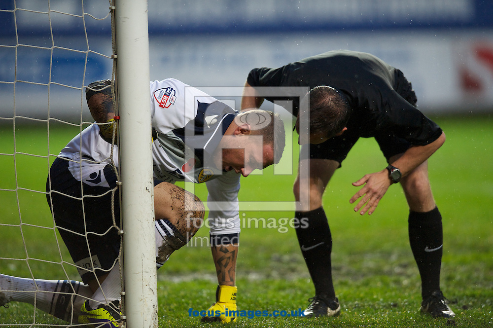 Picture by Alan Stanford/Focus Images Ltd +44 7915 056117<br /> 09/11/2013<br /> Goalkeeper Patrick Kenny of Leeds United is checked by Referee Mr Keith Stroud after taking a knock during the Sky Bet Championship match at The Valley, London.