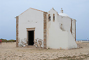 SAGRES, PORTUGAL - JULY 19, 2006: Unidentified people visit church of Our Lady of Grace at Sagres point in Sagres, Portugal.