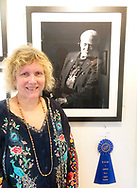 Manhasset, New York, U.S., September 8, 2019. Photographer Ann Parry poses by her Buzz Aldrin portrait, 1st Place winner of The Art Guild Portrait exhibit and competition.