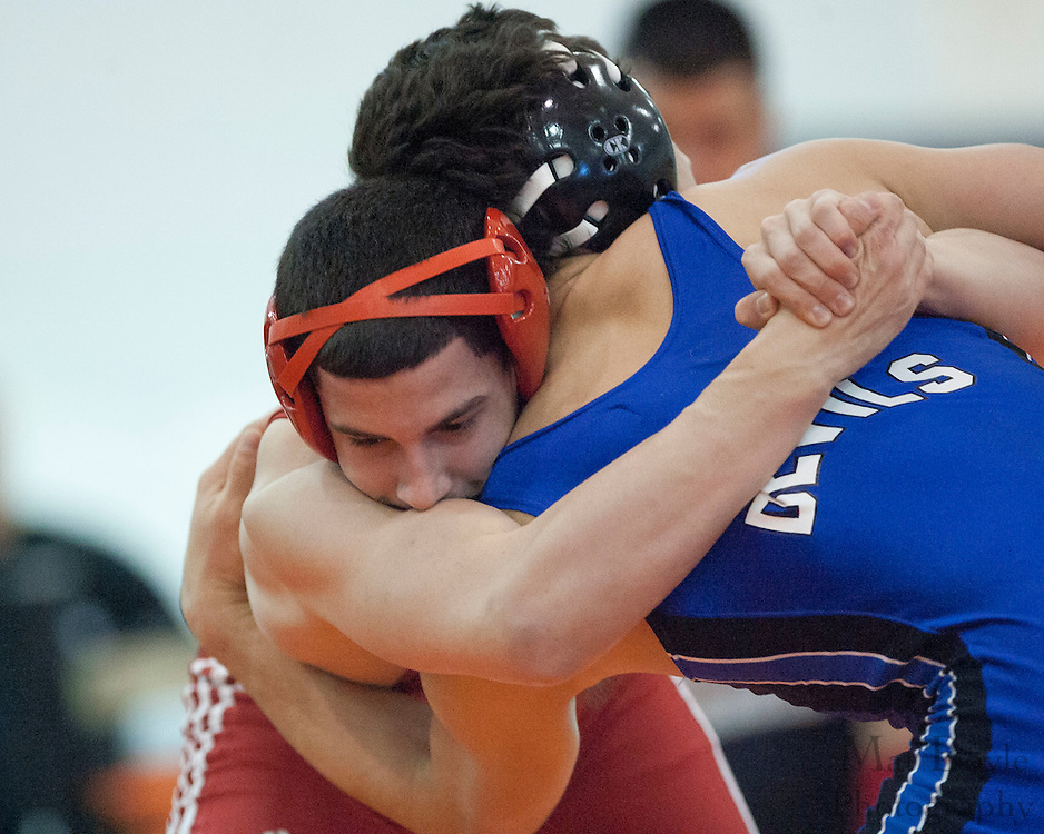 Nico Porretta of High School vs. Anthony Irvin of Triton Regional High School during the District 30 Wrestling 152 lbs weight class Semi-final at Overbrook High School on February 18, 2012. (photo / Mat Boyle)