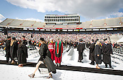 Graduates look on before the University of Wisconsin-Madison commencement ceremony at Camp Randall Stadium, Saturday, May 17, 2014.