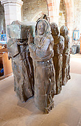 """""""The Journey"""" Sculpture of monks carrying body of Saint Cuthbert by Fenwick Lawson 1999 Holy Island, Northumberland, England, UK"""