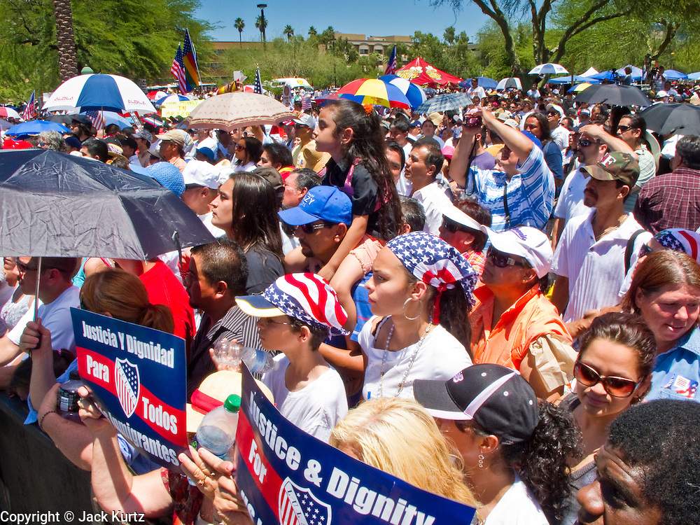 May 29 - PHOENIX, AZ: More than 30,000 people, supporters of immigrants' rights and opposed to Arizona SB1070, marched through central Phoenix to the Arizona State Capitol Saturday. SB1070 makes it an Arizona state crime to be in the US illegally and requires that immigrants carry papers with them at all times and present to law enforcement when asked to. Critics of the law say it will lead to racial profiling, harassment of Hispanics and usurps the federal role in immigration enforcement. Supporters of the law say it merely brings Arizona law into line with existing federal laws.  PHOTO BY JACK KURTZ