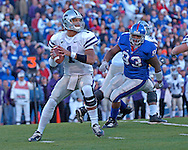 Kansas State quarterback Josh Freeman (1) drops back to pass under pressure from Kansas defensive tackle James McClinton (93) in the first half at Memorial Stadium in Lawrence, Kansas, November 18, 2006.  Kansas beat K-State 39-20.<br />