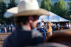 August 16, 2017 - Snowmass, Colorado, USA - A cowboy looks on from the side of the arena as a rodeo competitor warms up. (Credit Image: © Alex Edelman via ZUMA Wire)
