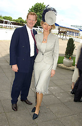 The EARL & COUNTESS OF DERBY at Ladies Day at Epsom Racecourse, Surrey during the Derby Festival on 3rd June 2005.<br />