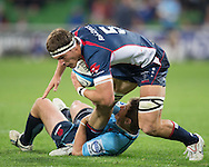 Luke Jones (Rebels) is tackled by Bernard Foley (Waratahs) during the Round 15 match of the 2013 Super Rugby Championship between RaboDirect Rebels vs HSBC Waratahs at AAMI Park, Melbourne, Victoria, Australia. 24/05/0213. Photo By Lucas Wroe