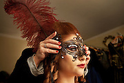 A woman tries a mask during the carnival in Venice.