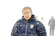 SHOT 3/22/13 9:00:54 PM - United State's men's soccer team head coach Jurgen Klinsmann during the team's game against Costa Rica in their World Cup qualifying game at Dick's Sporting Goods Park in Commerce City, Co. on Friday March 22, 2013. The U.S. won the game 1-0 in a spring blizzard that blanketed the field and stadium in snow. (Photo by Marc Piscotty / © 2013).