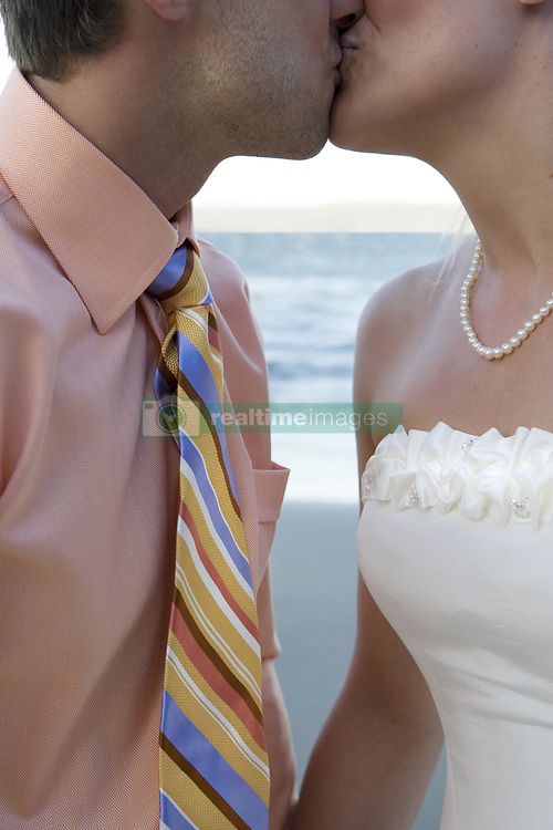 July 21, 2019 - Bride And Groom Kissing By Sea (Credit Image: © Caley Tse/Design Pics via ZUMA Wire)
