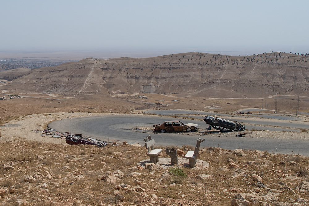 Car wrecks lie in Shingal mountains. The cars belonged to Ezidi people who tried to flee in the mountains when ISIS overran the area on August 3, 2014. Shingal (Sinjar), Iraq, September 8, 2015