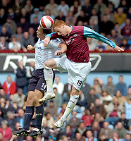 Photo: Ed Godden/Sportsbeat Images.<br /> West Ham United v Bolton Wanderers. The Barclays Premiership. 05/05/2007. West Ham's James Collins (R), leaps high with Bolton's Kevin Davies.