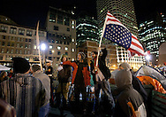 Boston, MA 12/09/2011.Occupy Boston protestors recite the First Amendment after the passing of the city's deadline to vacate Dewey Square early Friday morning..Alex Jones / www.alexjonesphoto.com