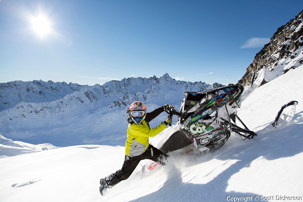 Carly Davis snowmachining in Alaska.