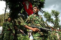 Members of the People?s Liberation Army, the Maoist rebels that have been fighting for control of the country, keep guard in a remote part of western Nepal on June 22, 2006. The ten-year old conflict in Nepal has claimed an estimated 13,000 lives. (Photo/Scott Dalton)