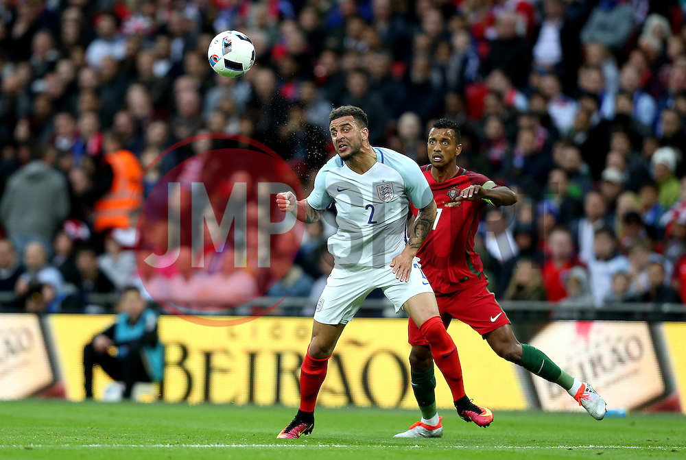 Kyle Walker of England heads the ball clear from Nani of Portugal - Mandatory by-line: Robbie Stephenson/JMP - 02/06/2016 - FOOTBALL - Wembley Stadium - London, United Kingdom - England v Portugal - International Friendly