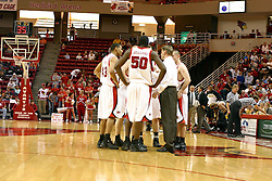 08 January 06  Redbirds huddle on the floor with Coach Porter Moser as the officials watch the replay monitor to determine whether a basket by the Shockers was a 2 or 3 point shot.....The Illinois State Redbirds come up short against the Witchita State Shockers.  The Shockers put on a 2nd half show that left the Redbirds trailing 56 - 47 at the bell.  Dana Ford of the Redbirds matched his career high with 16 points, adding 7 boards and 4 steals.....Redbird Arena, Illinois State University  campus, Normal, Illinois